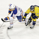 Nashville Predators left wing Taylor Beck (41) tries to slow down Edmonton Oilers center Leon Draisaitl (29), of Germany, in the third period of an NHL hockey game Thursday, Nov. 27, 2014, in Nashville, Tenn. Beck was penalized for hooking on the play. Th