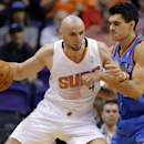 Phoenix Suns center Marcin Gortat, of Poland, backs down Oklahoma Thunder center Steven Adams, right, during the first half of an NBA preseason basketball game, Tuesday, Oct. 22, 2013, in Phoenix. (AP Photo/Matt York)