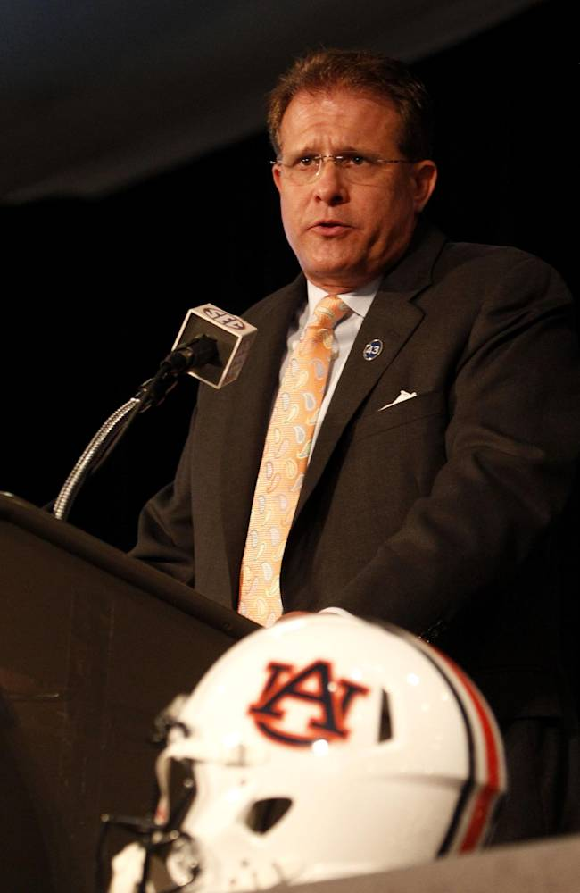 Auburn coach Gus Malzahn speaks during SEC media days on Monday, July 14, 2014, in Hoover, Ala
