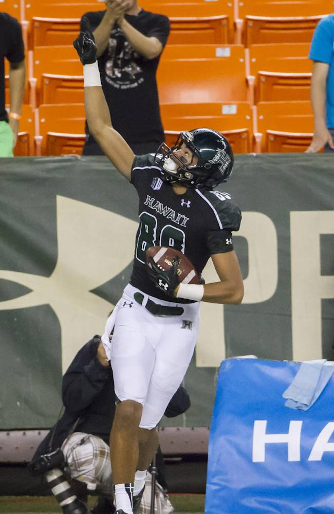 Hawaii wide receiver Keith Kirkwood (89) celebrates a touchdown in the third quarter of an NCAA college football game Saturday, Sept. 28, 2013, in Honolulu
