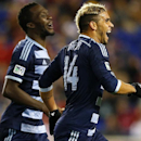 Sporting Kansas City forward C.J. Sapong, left, celebrates with forward Dom Dwyer (24) who scored in the second half against the New York Red Bulls during an MLS playoff soccer match at Red Bull Arena in Harrison, N.J., Thursday, Oct. 30, 2014. The Red Bu
