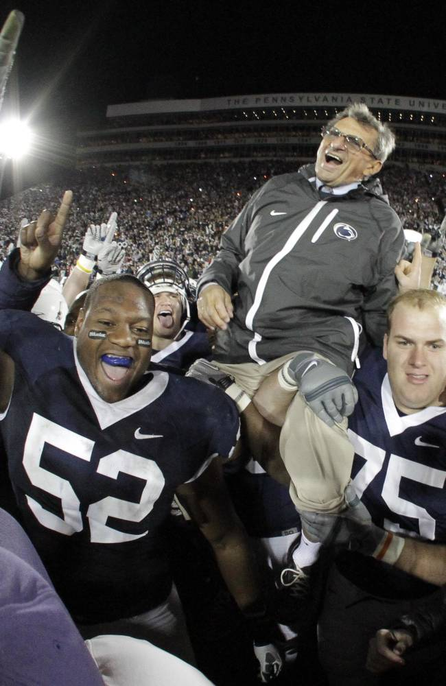FILE - In this Nov. 6, 2010, file photo, Penn State coach Joe Paterno is carried off the field by his players after getting his 400th collegiate win over Northwestern 38-21 in an NCAA college football game in State College, Pa. Ahead of the college football season, The Associated Press asked its panel of voters in the Top 25 poll to weigh in on the best coaches in college football history, not counting active coaches. JoePa won 409 games, more than any coach in major college coach, though 111 were later vacated by the NCAA. (AP Photo/Gene J. Puskar, File)