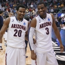 Arizona's Jordin Mayes, left, and Kevin Parrom celebrate the team's 74-51 win over Harvard in a third-round NCAA college basketball tournament game in Salt Lake City on Saturday, March 23, 2013. (AP Photo/George Frey)