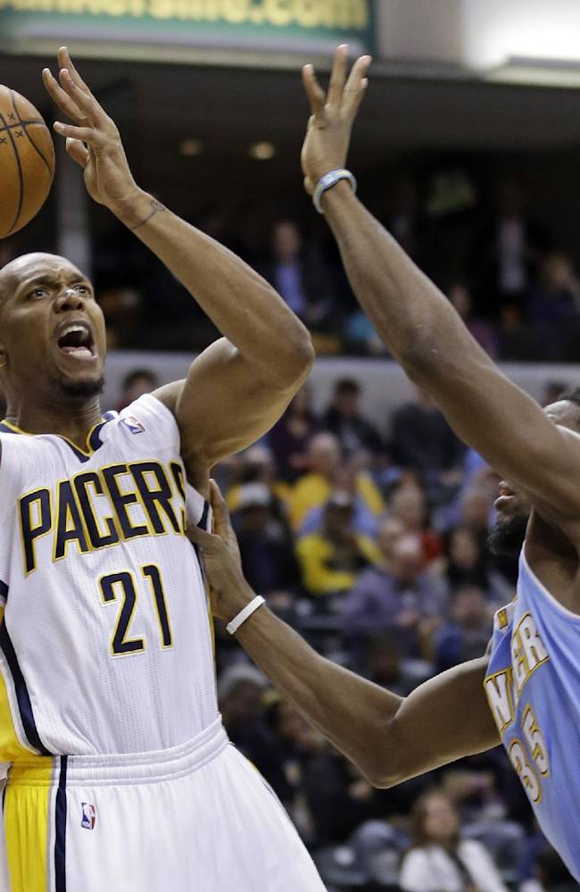 Indiana Pacers forward David West (21) shoots over Denver Nuggets forward Kenneth Faried in the second half of an NBA basketball game in Indianapolis, Monday, Feb. 10, 2014. The Pacers defeated the Nuggets 119-80