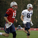 New England Patriots tight end Rob Gronkowski (87) runs a sprint next to quarterback Tom Brady (12) during practice Thursday, Jan. 29, 2015, in Tempe, Ariz. The Patriots play the Seattle Seahawks in NFL football Super Bowl XLIX Sunday, Feb. 1 The Associat