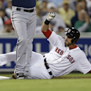 Boston Red Sox Will Middlebrooks slides into third on a triple as Minnesota Twins third baseman Trevor Plouffe covers the bag in the fifth inning of an exhibition baseball game in Fort Myers, Fla., Thursday, March 27, 2014 The Associated Press