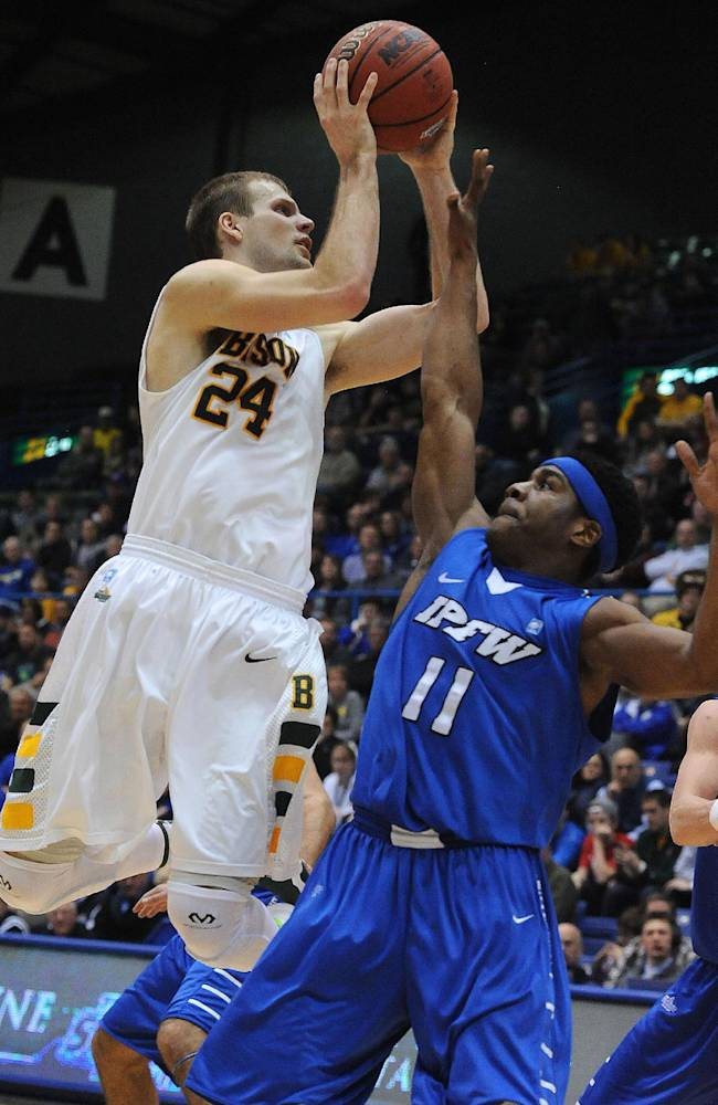 North Dakota State's Taylor Braun goes up for a shot over Indiana-Purdue-Fort Wayne's Isaiah McCray during the second half of an NCAA college basketball game for the Summit League men's tournament title, Tuesday, March 11, 2014, Sioux Falls, S.D. North Dakota State won 60-57
