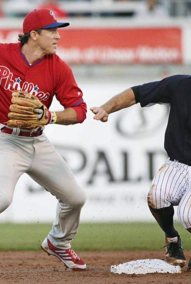 Philadelphia Phillies second baseman Chase Utley (26) forces out New York Yankees Brett Gardner after the Yankees Carlos Beltran grounded into the play in the first inning of a spring exhibition baseball game in Tampa, Fla., Tuesday, March 25, 2014.  The Phillies shutout the Yankees 6-0