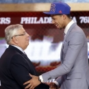 NBA Commissioner David Stern, left, shakes hands with Syracuse's Michael Carter-Williams, who was selected by the Philadelphia 76ers in the first round of the NBA basketball draft, Thursday, June 27, 2013, in New York. (AP Photo/Kathy Willens)