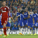 Chelsea celebrates the opening goal by Cesc Fabregas, 2nd from right, behind Schalke's goalkeeper Ralf Faehrmann, left, during the Champions League Group G soccer match between Chelsea and Schalke 04 at Stamford Bridge stadium in London Wednesday, Sept.