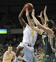 West Virginia's Juwan Staten (3) drives to score as William & Mary's Omar Prewitt (4) defends during the first half of an NCAA college basketball game in Charleston, W.Va., on Sunday, Dec. 29, 2013. (AP Photo/Tyler Evert)