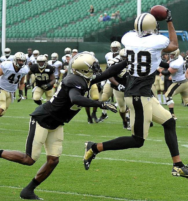 New Orleans Saints wide receiver Nick Toon (88) receives a pass next to cornerback Champ Bailey (27) during NFL football training camp in White Sulphur Springs, W.Va., Sunday, July 27, 2014