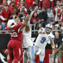 Detroit Lions quarterback Matthew Stafford (9) throws against the Arizona Cardinals during the first half of an NFL football game, Sunday, Nov. 16, 2014, in Glendale, Ariz The Associated Press