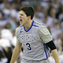 Creighton's Doug McDermott (3) reacts after scoring against Providence in the first half on an NCAA college basketball game in Omaha, Neb., Saturday, March 8, 2014. (AP Photo/Nati Harnik)