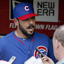 Chicago Cubs' Carlos Villanueva talks with reporters in the dugout prior to an exhibition baseball game against the Arizona Diamondbacks, Friday, March 28, 2014, in Phoenix The Associated Press