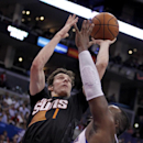 Phoenix Suns guard Goran Dragic (1), of Slovenia shoots over Los Angeles Clippers forward Glen Davis, right, during the second half of an NBA basketball game Monday, March 10, 2014, in Los Angeles. Clippers won 112-105 The Associated Press