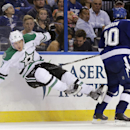 Tampa Bay Lightning left wing Brenden Morrow, right, sends Dallas Stars center Shawn Horcoff flying on a check during the third period of an NHL preseason hockey game Friday, Sept. 26, 2014, in Tampa, Fla. Tampa Bay won 6-3. The Associated Press