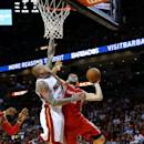 MIAMI, FL - OCTOBER 21:  Kostas Papanikolaou #16 of the Houston Rockets drives on Chris Andersen #11 of the Miami Heat during a preseason game  at American Airlines Arena on October 21, 2014 in Miami, Florida. NOTE TO USER: User expressly acknowledges and agrees that, by downloading and/or using this photograph, user is consenting to the terms and conditions of the Getty Images License Agreement. Mandatory copyright notice:  (Photo by Mike Ehrmann/Getty Images)