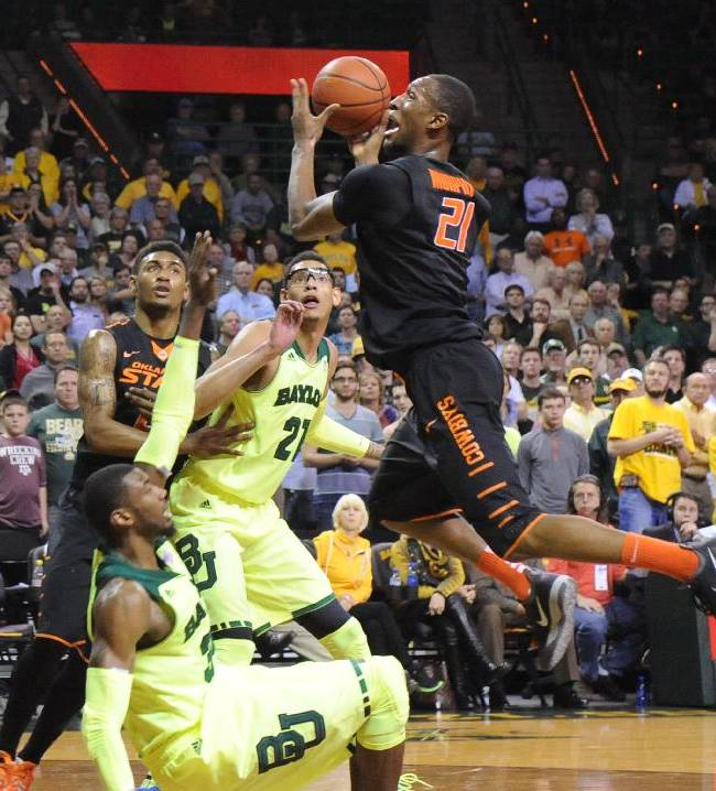 Oklahoma State center Kamari Murphy (21) attempts a shot over Baylor forward Cory Jefferson (34), left, in the second half of an NCAA college basketball game, Monday, Feb. 17, 2014, in Waco, Texas. Baylor won in overtime 70-64