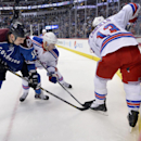 Colorado Avalanche left wing Patrick Bordeleau (58), New York Rangers defenseman John Moore, center, and Daniel Carcillo (13) fight for the puck during the first period of an NHL hockey game on Thursday, April 3, 2014, in Denver The Associated Press