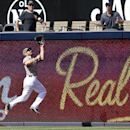 San Diego Padres right fielder Xavier Nady jumps at the fence to make the catch on a long drive hit by San Francisco Giants' Gregor Blanco in the eighth inning of a baseball game Sunday, April 20, 2014, in San Diego The Associated Press