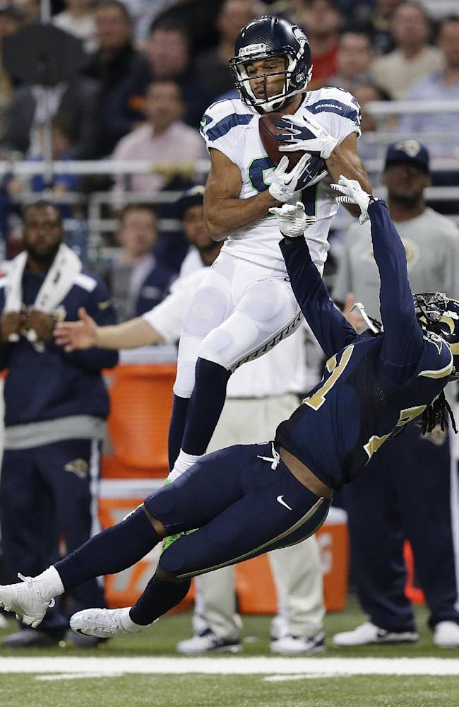 Seattle Seahawks wide receiver Golden Tate (81) makes a catch against St. Louis Rams cornerback Janoris Jenkins (21) during the second half of an NFL football game, Monday, Oct. 28, 2013, in St. Louis. Tate ran the ball into the end zone for a touchdown