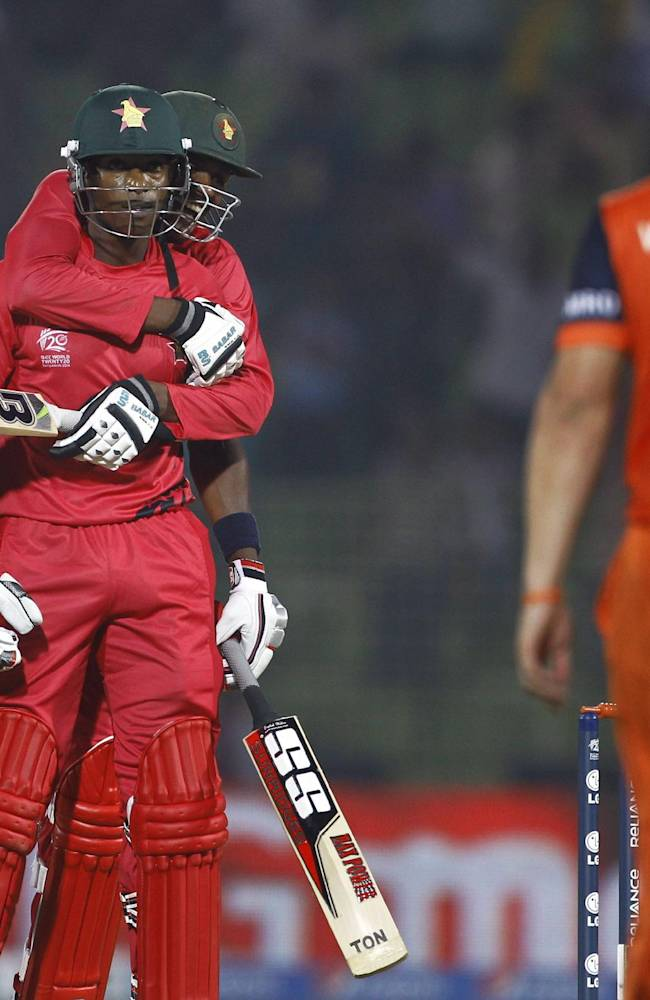 Zimbabwe's Vusi Sibanda jumps on to the back of teammate Timycen Maruma in celebration after winning  their ICC Twenty20 Cricket World Cup match against the Netherlands in Sylhet, Bangladesh, Wednesday, March 19, 2014
