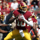 In this Sept. 14, 2014 file photo, Washington Redskins quarterback Robert Griffin III (10) looks to pass during the first half of an NFL football game against the Jacksonville Jaguars in Landover, Md. After six-plus games on the sideline, Robert Griffin I