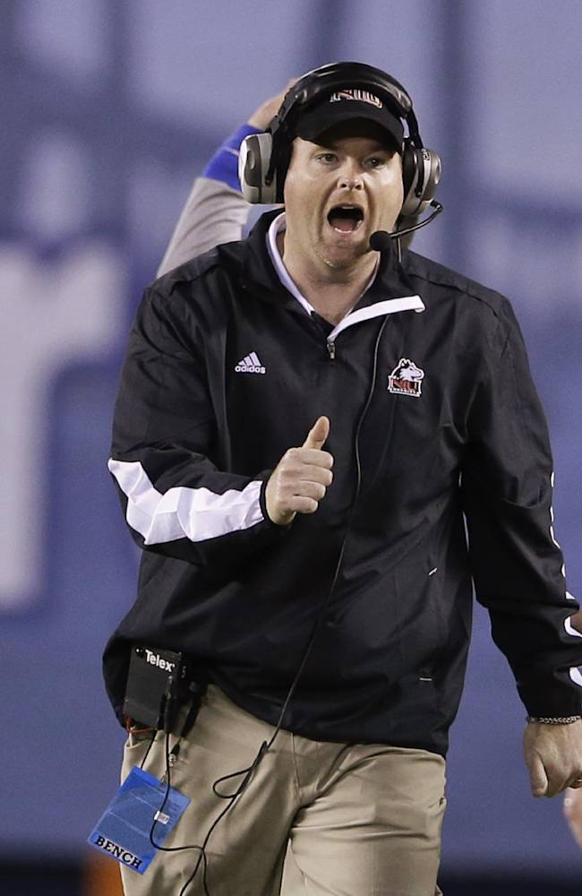 Northern Illinois coach Rod Carey shouts during the first half of the Poinsettia Bowl NCAA college football game against Utah State on Thursday, Dec. 26, 2013, in San Diego