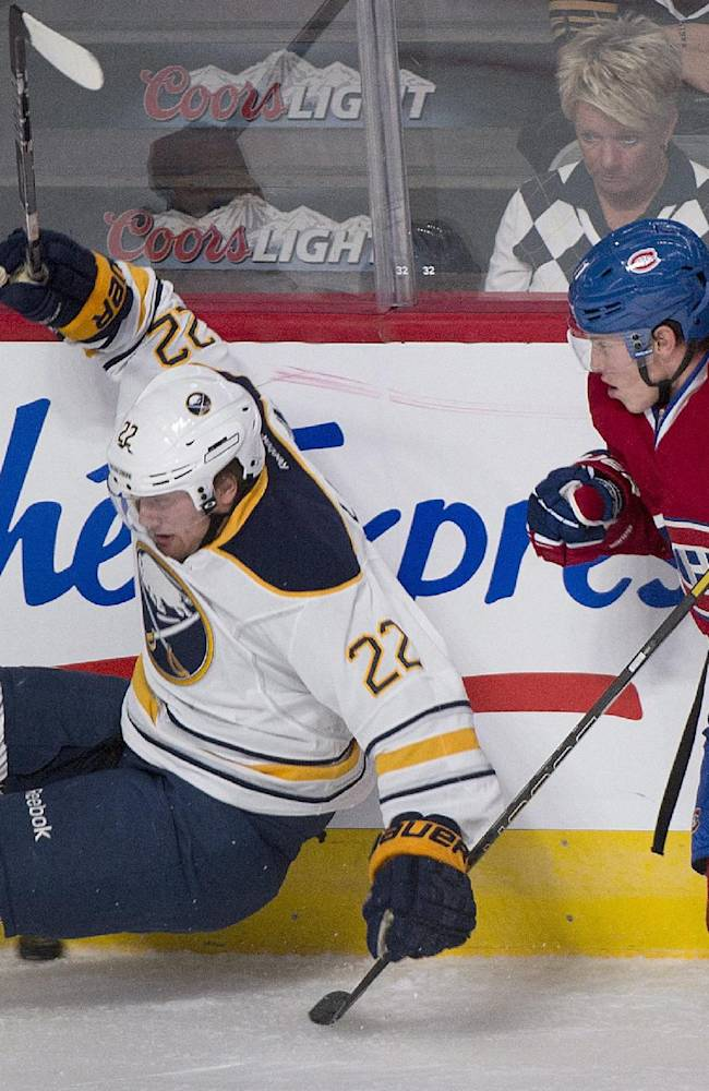 Montreal Canadiens' Brendan Gallagher, right, and Buffalo Sabres' Johan Larsson collide during the first period of an NHL pre-season hockey game, Sunday, Sept. 15, 2013 in Montreal