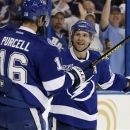 Tampa Bay Lightning right wing Martin St. Louis, right, celebrates with teammate Teddy Purcell after scoring against the Flor