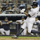 In this Aug. 21, 2013 file photo, New York Yankees' Curtis Granderson hits an RBI single during the third inning of a baseball game against the Toronto Blue Jays, in New York. A person familiar with the situation says free-agent outfielder Granderson and