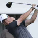 Rory McIlroy hits on the ninth tee shot during a practice round for the Cadillac Championship golf tournament in Doral, Fla., Wednesday, March 4, 2015. (AP/J Pat Carter)