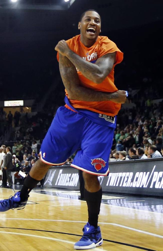 New York Knicks forward Carmelo Anthony celebrates in the last seconds of the Knicks' 103-102 victory over the Boston Celtics in a preseason NBA basketball game in Providence, R.I., Wednesday, Oct. 9, 2013