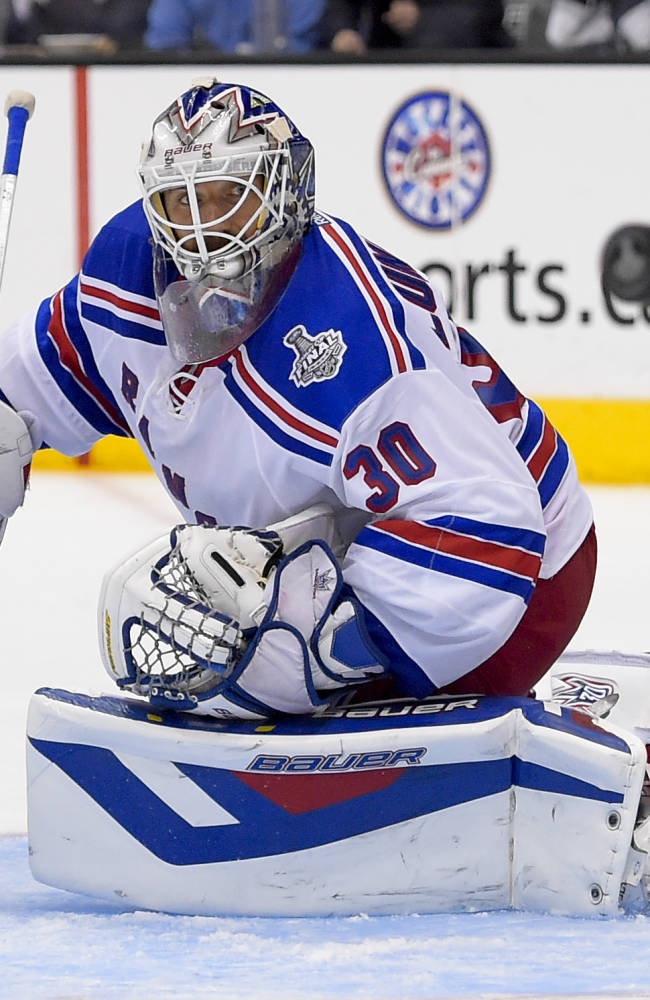New York Rangers goalie Henrik Lundqvist, of Sweden, blocks ascot against the Los Angeles Kings during overtime in Game 2 in the NHL hockey Stanley Cup Finals in Los Angeles, Saturday, June 7, 2014