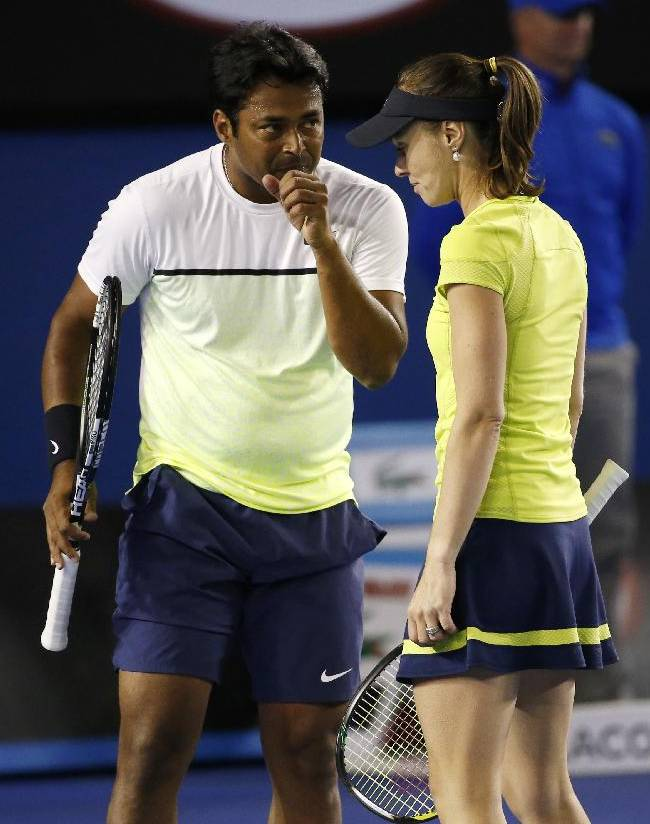 Martina Hingis of Switzerland, right, and Leander Paes of India talk between plays as they play Czech Republic's Andrea Hlavackova and Austria's Alexander Peya in their mixed doubles quarterfinal match at the Australian Open tennis championship in Melbourne, Australia, Wednesday, Jan. 28, 2015