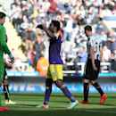 Swansea City's Wilfried Bony, center, celebrates his goal during their English Premier League soccer match against Newcastle United at St James' Park, Newcastle, England, Saturday, April 19, 2014