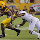 Arizona State running back D.J. Foster, left, tries to break an arm tackle by Weber State cornerback Deon'tae Florence during the first half of an NCAA college football game, Thursday, Aug. 28, 2014, in Tempe, Ariz The Associated Press