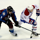 Colorado Avalanche center Matt Duchene, left, reaches out to stop a shot by Montreal Canadiens right wing Brendan Gallagher in the third period of the Canadiens' 4-3 victory in an NHL hockey game in Denver on Monday, Dec. 1, 2014 The Associated Press
