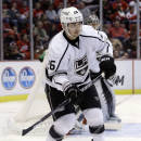 FILE - In this Jan. 18, 2014, file photo, Los Angeles Kings defenseman Slava Voynov (26), of Russia, looks on during the second period of an NHL hockey game against the Detroit Red Wings in Detroit. Voynov's attorney says Wednesday, Oct. 22, 2014, that Voynov never hit his girlfriend, and he blames his arrest on a misunderstanding partly caused by the couple's limited English. Craig Renetzky is hopeful the NHL will end Voynov's indefinite suspension after reviewing the events that led to Voynov's arrest at a hospital near his home. (AP Photo/Carlos Osorio, File)