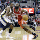 Houston Rockets' James Harden (13) drives to the basket as Utah Jazz's Jeremy Evans, left, defends in the second half of an NBA basketball game Monday, Dec. 2, 2013, in Salt Lake City. The Jazz won 109-103 The Associated Press