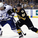 Boston Bruins left wing Brad Marchand (63) fights for position with Tampa Bay Lightning right wing Brett Connolly (14) during the third period of an NHL hockey game in Boston, Monday, Nov. 11, 2013. The Bruins won 3-0 The Associated Press