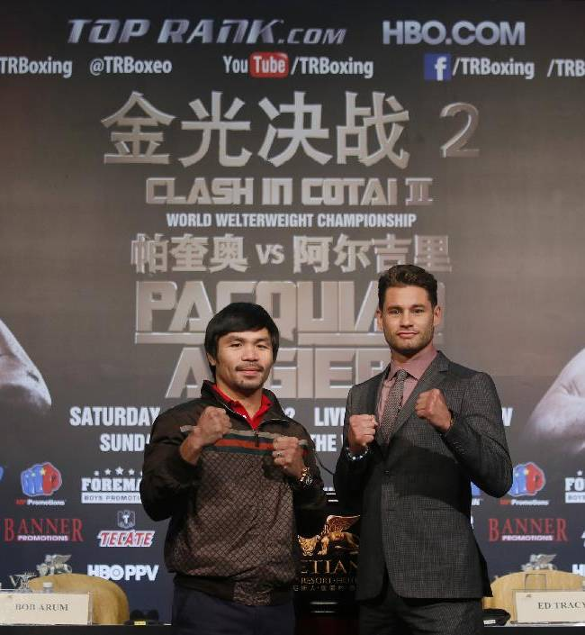 Boxers Manny Pacquiao, left, of the Philippines, and Chris Algieri of the United States, pose for photographers during a news conference in Macau, Monday, Aug. 25, 2014. The pair are scheduled to fight in a WBO welterweight title bout at the Venetian Macao on Nov. 23 in Macau