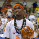 Syracuse forward C.J. Fair holds the most valuable player trophy fore the Maui Invitational on Wednesday, Nov. 27, 2013, in Lahaina, Hawaii. Syracuse defeated Baylor 74-67 in an an NCAA college basketball game to win the tournament. (AP Photo/Eugene Tanner)