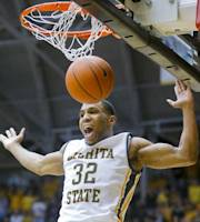 Wichita State's Tekele Cotton dunks after a steal against William & Mary during the second half of an NCAA college basketball game Thursday, Nov. 14, 2013, in Wichita, Kan. Wichita State won 79-62. (AP Photo/The Wichita Eagle, Fernando Salazar)