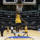 La Salle's Ramon Galloway, center, dunks during practice for a West Regional semifinal game in the NCAA college basketball tournament in Los Angeles, Wednesday, March 27, 2013. La Salle is to play Wichita State on Thursday. (AP Photo/Jae C. Hong)