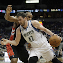 Minnesota Timberwolves forward Kevin Love (42) pushes the ball around Toronto Raptors forward Chuck Hayes (44) in the second half of an NBA basketball game, Sunday, March 9, 2014, in Minneapolis. The Raptors won 111-104 The Associated Press