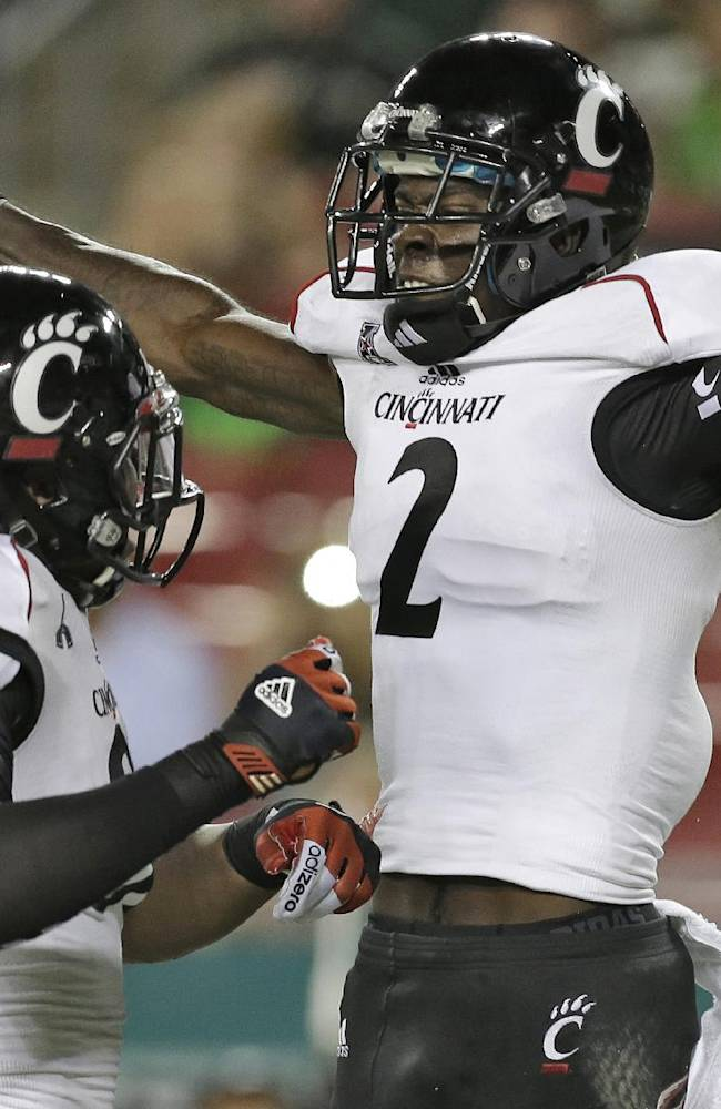 Cincinnati wide receiver Mekale McKay (2) celebrates with teammate tight end DJ Dowdy (81) after scoring ad touchdown during the second quarter of an NCAA college football game against South Florida Bulls on Saturday, Oct. 5, 2013, in Tampa, Fla