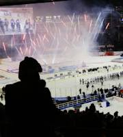 Fans watch The New York Rangers and the New York Islanders shake hands after an outdoor NHL hockey game, during a pyrotechnics display Wednesday, Jan. 29, 2014, at Yankee Stadium in New York. The Rangers won 2-1. (AP Photo/Frank Franklin II)