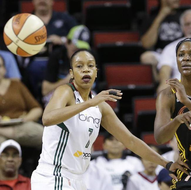 Tulsa Shock's Tiffany Jackson-Jones, right, passes in front of Seattle Storm's Tina Thompson in the first half of a WNBA basketball game Saturday, Sept. 14, 2013, in Seattle